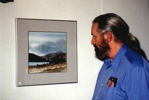 Bob Richardson with one of his paintings at an art show in Mackenzie, BC in 1997